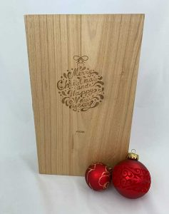Tipple for two? Surprise a much-loved couple this Christmas with a personalised, double- hinged Tung wood wine box that holds two bottles.